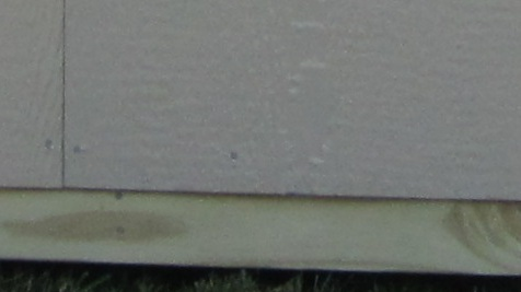 caulking siding of shed