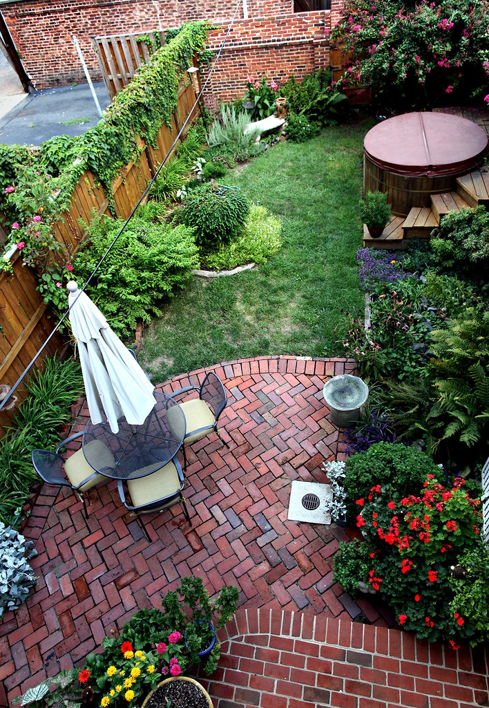 Small Backyard Big Ideas :  , great example of a functional perimeter backyard garden ( NYT