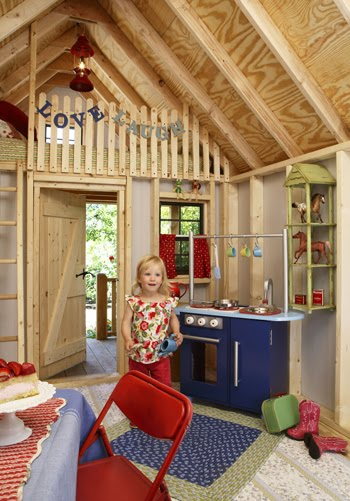 A nifty Kid Cave with cute kitchen and matching throw rugs. Source: Built By Kids