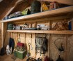 Shelf & storage loft help keep items organized & off the floor.